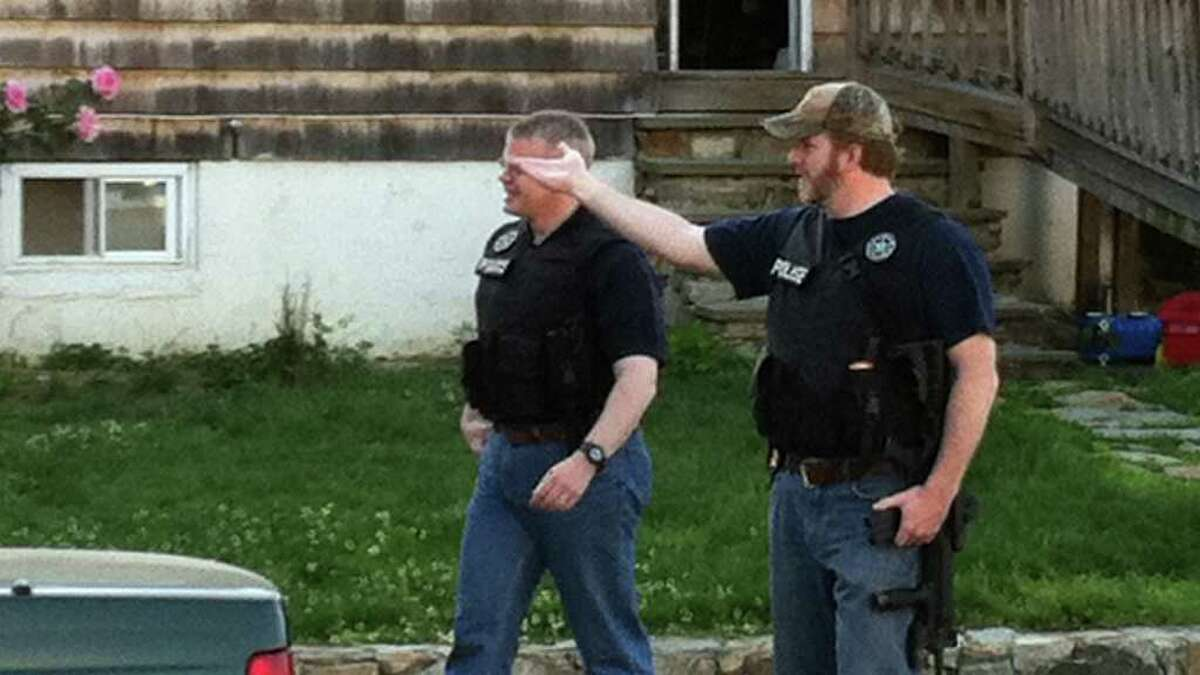 Stamford police officers serve a murder warrant on Jonathan Catchings, at 46 Durant St., in Stamford, Conn. on Thursday, June 2, 2010. The warrant was related to the murder of Raymond Hayward, who was shot to death near Rose Park Avenue near Richmond Hill Avenue on May 27, 2011.
