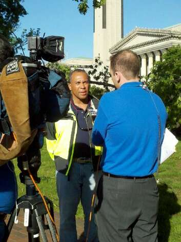 Massachusetts Gov. Deval Patrick talks to reporters Thursday morning after taking a helicopter tour of the Springfield area where massive tornadoes killed four people and damaged or destroyed countless homes and businesses. (Dayelin Roman / Times Union)