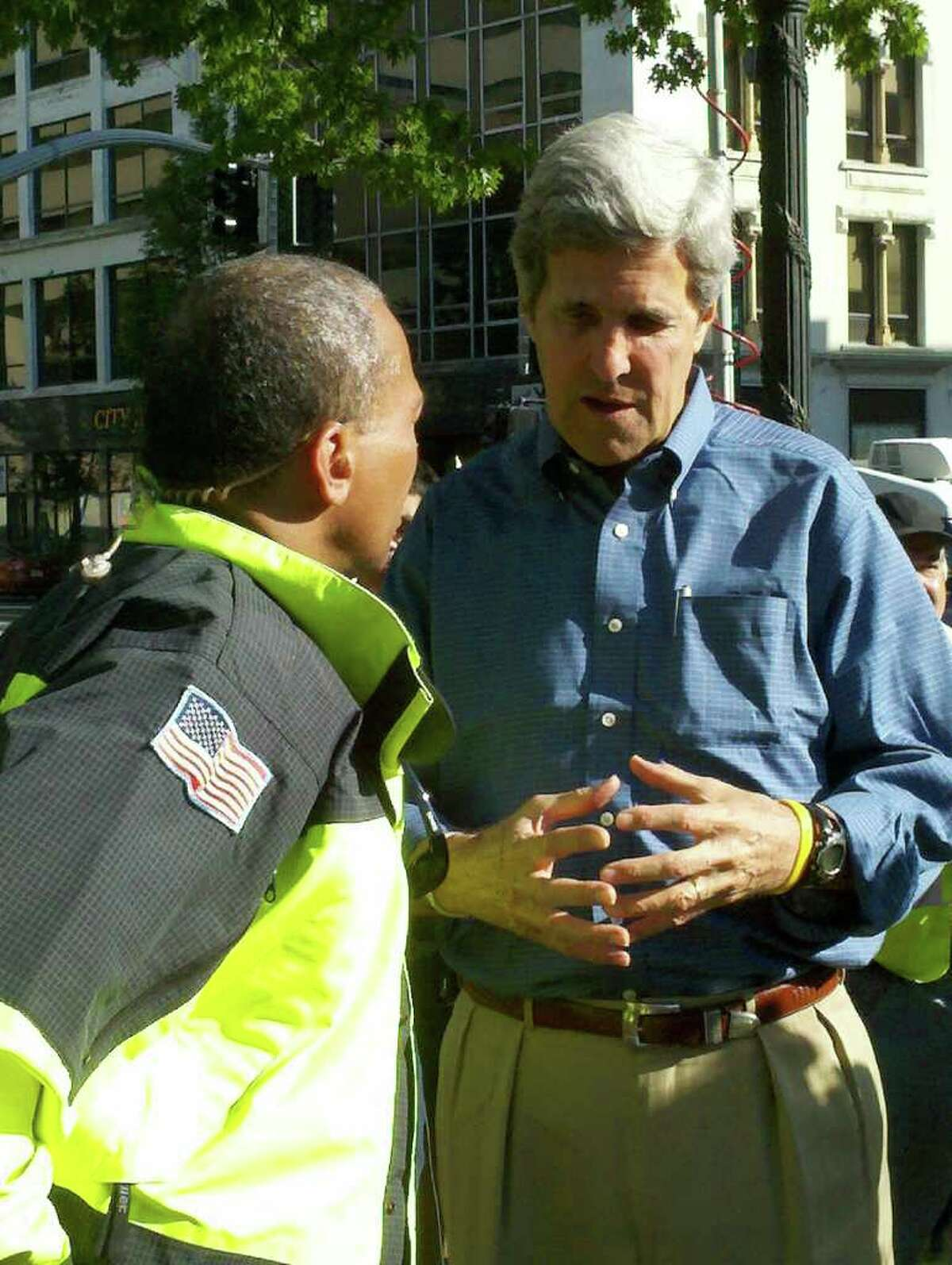 Massachusetts Gov. Deval Patrick, left, speaks to Sen. John Kerry, D-Mass., on Thursday, a day after massive tornadoes killed four people and damaged or destroyed homes and businesses in western Massachusetts. (Dayelin Roman / Times Union)