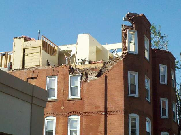 The top floor of this apartment building in Springfield, Mass., was torn apart by a tornado Wednesday that slammed into the city. (Dayelin Roman / Times Union)