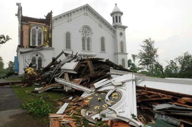 The steeple of The First Church of Monson lays in rubble on the ground after a tornado swept through the downtown area of Monson, Mass., Wednesday, June 1, 2011.  (AP Photo/Worcester Telegram & Gazette, Tom Rettig) Photo: Tom Rettig