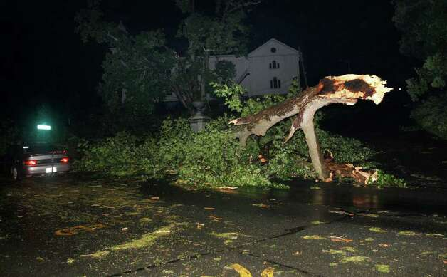 Large trees and debris litter a street Wednesday after a tornado swept through Monson, Mass.  (Elise Amendola / Associated Press) Photo: Elise Amendola