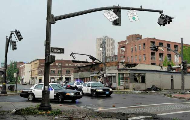 Storm damage is seen in downtown Springfield, Mass., Wednesday, June 1, 2011.  An apparent tornado struck the downtown of one of the state's largest cities on Wednesday afternoon, scattering debris, toppling trees and frightening workers and residents. Several injuries were reported. (AP Photo/Jessica Hill) Photo: Jessica Hill