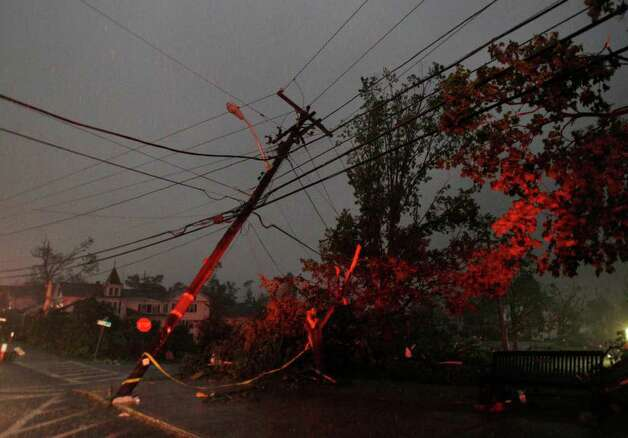 Power lines, lit up by emergency vehicle lights, are downed after a tornado Wednesday swept through Monson, Mass. (Elise Amendola / Associated Press) Photo: Elise Amendola
