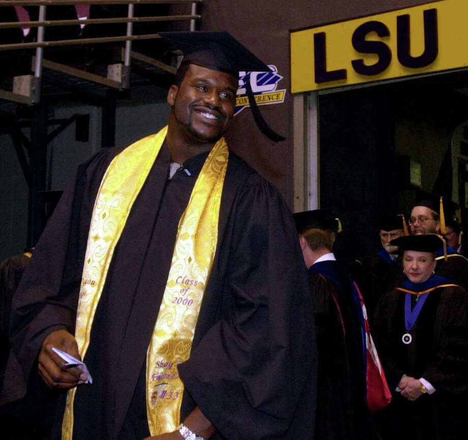 NBA star Shaquille O'Neal is all smiles as he walks into LSU graduation ceremonies at LSU Friday morning Dec. 15, 2000 in Baton Rouge, La. O'Neal, 28, left LSU in 1992 after three years to turn pro, but he kept his promise to his family and himself to continue his education. Photo: BILL HABER, AP / AP