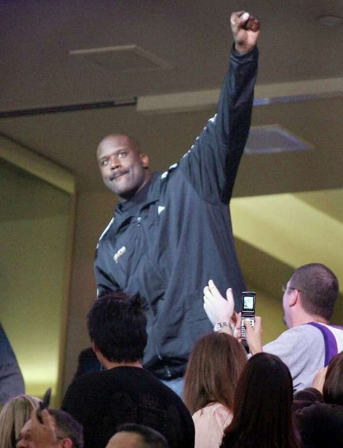 Phoenix Suns newly-acquired center Shaquille O'Neal acknowledges fans after being introduced as the Suns play against the New Orleans Hornets in an NBA basketball game, Wednesday, Feb,  6, 2008 in Phoenix. The Suns acquired O'Neal in a stunning, blockbuster deal that sent four-time All-Star Shawn Marion and Marcus Banks to the Miami Heat on Wednesday. (AP Photo/East Valley Tribune, Ralph Freso) ** ARIZONA REPUBLIC OUT ** Photo: Ralph Freso, AP / East Valley Tribune