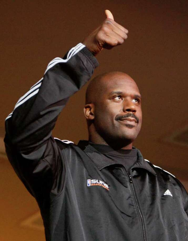 Phoenix Suns newly-acquired center Shaquille O'Neal gives a thumbs up to the crowd after being introduced as the Suns play against the New Orleans Hornets in an NBA basketball game, Wednesday, Feb,  6, 2008 in Phoenix. The Suns acquired O'Neal in a stunning, blockbuster deal that sent four-time All-Star Shawn Marion and Marcus Banks to the Miami Heat on Wednesday. (AP Photo/The Arizona Republic, Rob Schumacher) ** MARICOPA COUNTY OUT, MESA TRIBUNE OUT, MAGS OUT, NO SALES ** Photo: Rob Schumacher, AP / The Arizona Republic