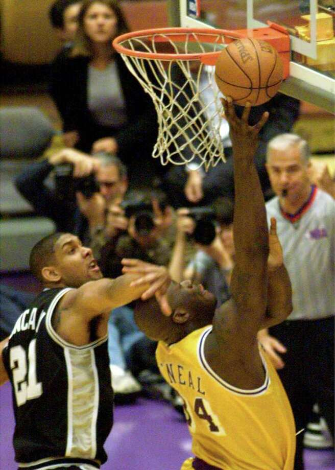 Spurs Tim Duncan fouls Lakers Shaquille O'Neal during first quarter action.(DOUG SEHRES/STAFF)