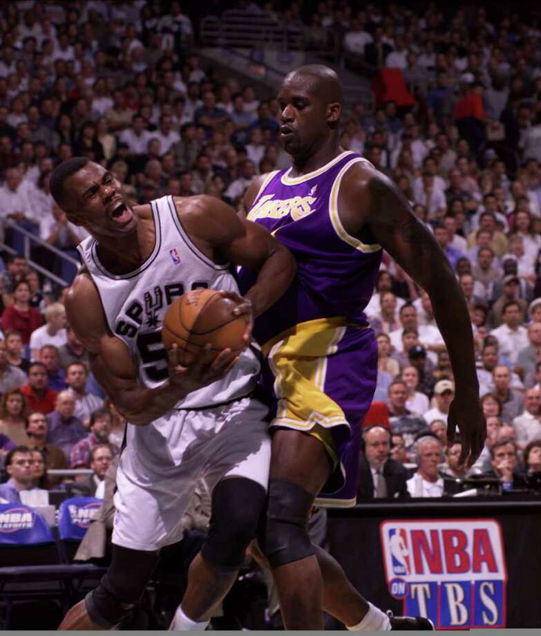 Shaq and David battle during first quarter as david works to the basket.(JERRY LARA/STAFF)
