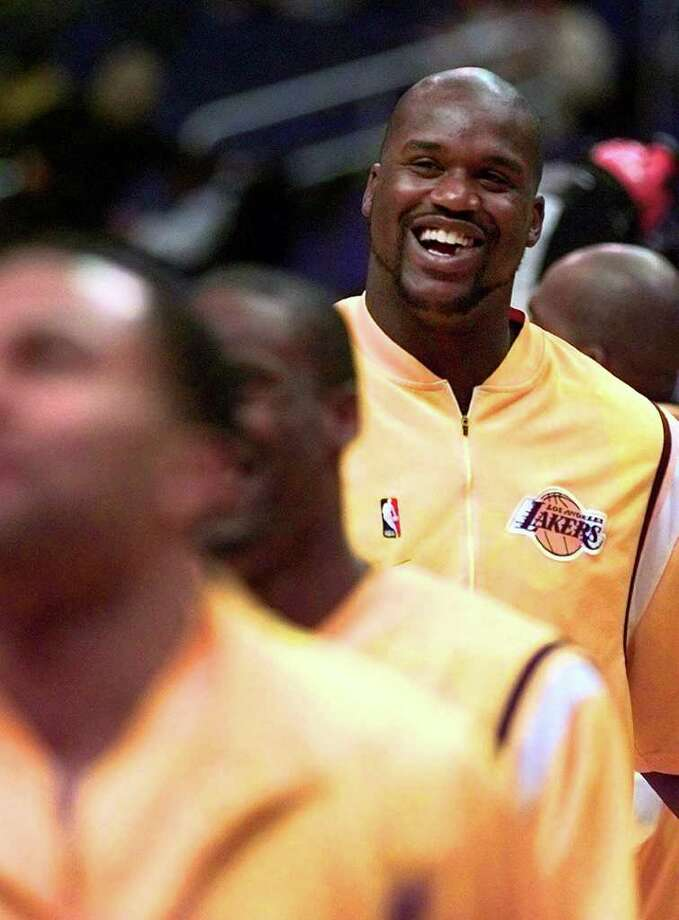 ADVANCE FOR WEEKEND EDITIONS, DEC. 18-19 -- Los Angeles Lakers' Shaquille O'Neal smiles prior to his game against cross-town rival Los Angeles Clippers in Los Angeles Tuesday, Dec. 14, 1999. Scary news for the rest of the NBA: Shaquille O'Neal is playing more, scoring more, dishing off assists, blocking shots, becoming an even more dominant player.(AP Photo/Michael  Caulfield) Photo: MICHAEL CAULFIELD, Associated Press / AP