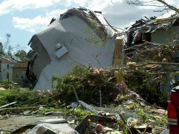 Wednesday's tornado partially collapsed a house on William Street in Springfield, Mass. (Dayelin Roman / Times Union)