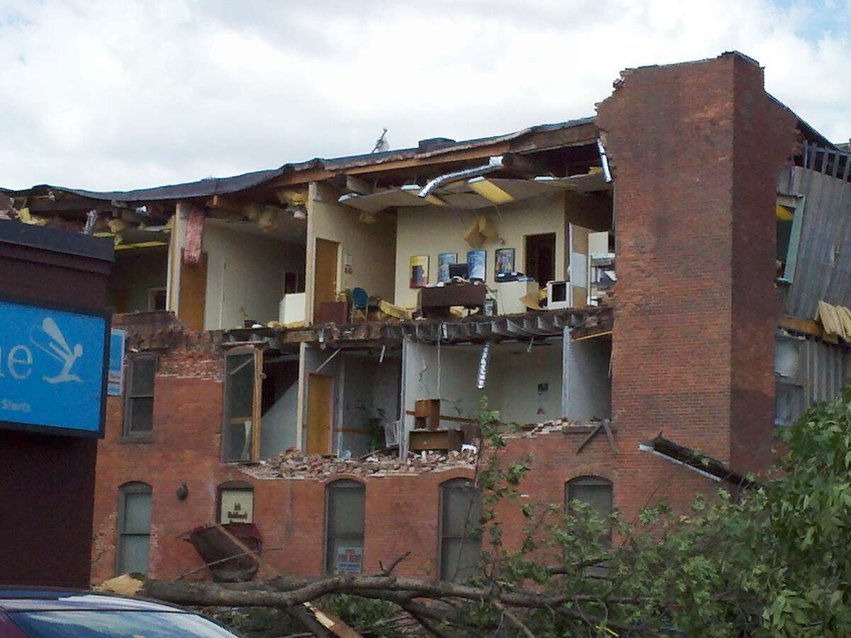Damage is widespread Thursday, in Springfield, Mass., a day after two tornadoes touched down in western Massachusetts. (Dayelin Roman / Times Union)