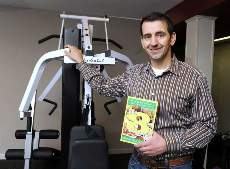 "Stavros Mastrogiannis, owner of Olympus Personal Training & Weight Mangement, has a new book out called ""The 8 Eating Rules."" Photo taken Tuesday, May 17, 2011. Photo: Carol Kaliff / The News-Times"
