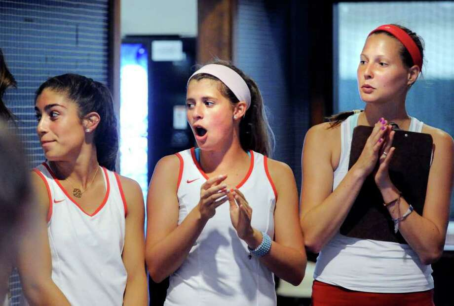 Left to right, Jen DeLuca, Katey Hopper and Michelle Vogt, all of the Greenwich High School girls tennis team cheer during introductions before the girls high school Class L tennis playoff match between Greenwich High School and Staples High School at Sound Shore Indoor Tennis, Port Chester, N.Y., Wednesday afternoon, June 1, 2011. Photo: Bob Luckey / Greenwich Time