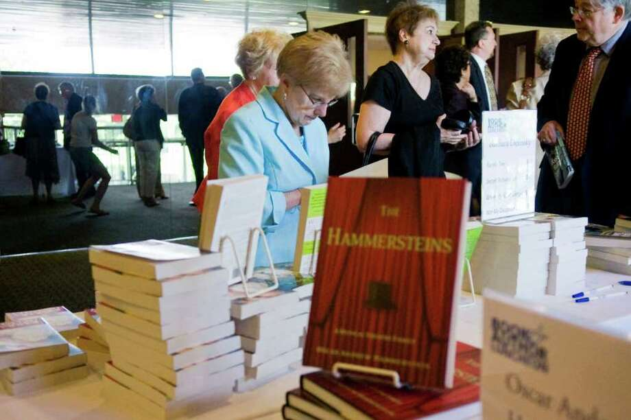 Guests browse the book selection as authors Barbara Delinsky, Oscar Andrew Hammerstein and Rachel Simon highlight the Book & Author Luncheon presented by Friends of Ferguson at The Italian Center in Stamford, Conn. on Thursday June 2, 2011. Photo: Kathleen O'Rourke / Stamford Advocate