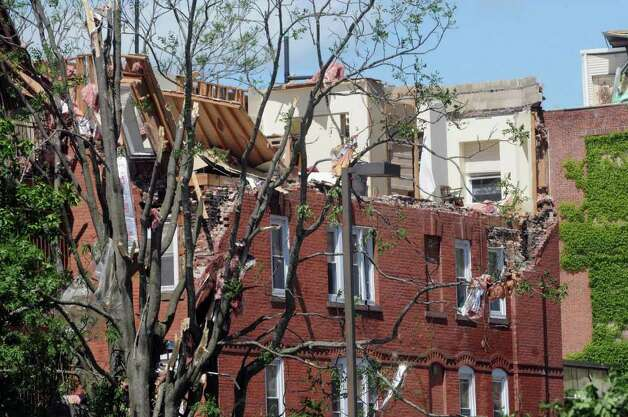 The roof of an apartment building on Union Street was torn off by a tornado that touched down Wednesday in Springfield, Mass.  (Paul Buckowski / Times Union) Photo: Paul Buckowski