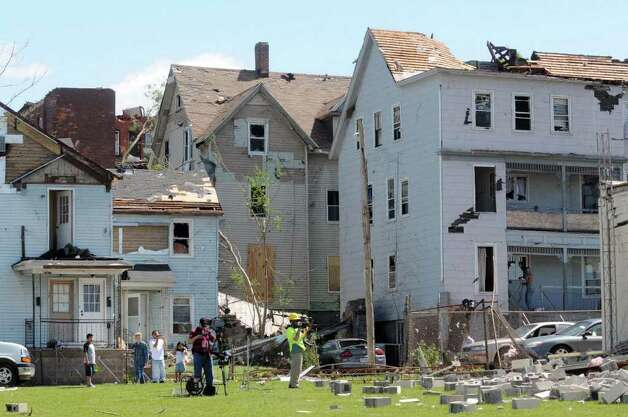These homes were damaged after deadly tornadoes struck Springfield, Mass., and surrounding communities on Wednesday, June 1, 2011.   (Paul Buckowski / Times Union) Photo: Paul Buckowski
