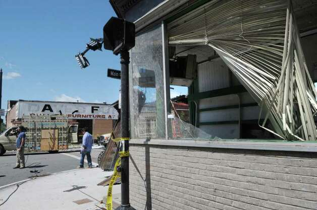 Damaged buildings and twisted traffic lights on Main St. are seen here on Thursday morning June 2, 2011 after a tornado struck in downtown Springfield on Wednesday.  A portion of downtown Springfield sustained heavy damage from the storm that came through and fire and rescue crews were still searching buildings on Thursday morning.  (Paul Buckowski / Times Union) Photo: Paul Buckowski