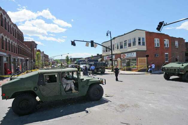 Members of the Massachusetts National Guard drive across Main Street, Springfield, Mass., on Thursday, June 2, 2011. The day after a deadly tornadoes struck western Massachusetts. (Paul Buckowski / Times Union) Photo: Paul Buckowski