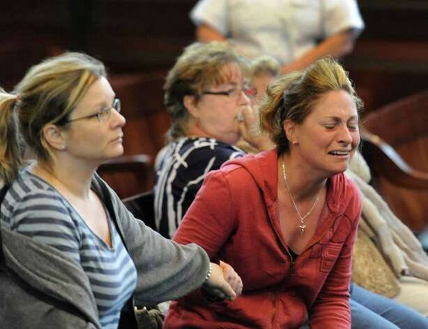 A relative of  Michael Mosley reacts after a jury convicted him of killing a Troy couple nine years ago in Troy.  (Skip Dickstein / Times Union) Photo: SKIP DICKSTEIN / 2008