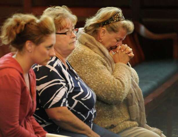 "Michael Mosley's mother, Wilma, raises her hands in prayer as she waited for jurors to deliver a verdict at Mosley' murder trial. Mosley was convicted for murder for killing Samuel 'Frost"" Holley, 27, and Arica Lynn Schneider, 18, nine years ago in Troy.  Moments after the verdict was delivered, Wilma Mosley collapsed on the floor of the court room and had to be taken to the hospital by Troy firefighters.  (Skip Dickstein / Times Union) Photo: SKIP DICKSTEIN / 2008"