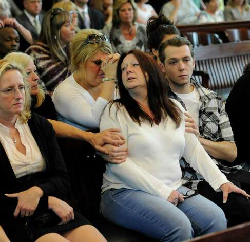 Robin Ritrovato, mother of Arica Schneider, is comforted by her relatives  before Michael Mosley was convicted of murdering her daughter and the young woman's boyfriend. She is shown in Rensselaer County Court House in Troy, N.Y., on June 2, 2011. Mosley was sentenced Tuesday to life in prison without the possibility of parole.  (Skip Dickstein / Times Union archive) Photo: SKIP DICKSTEIN / 2008