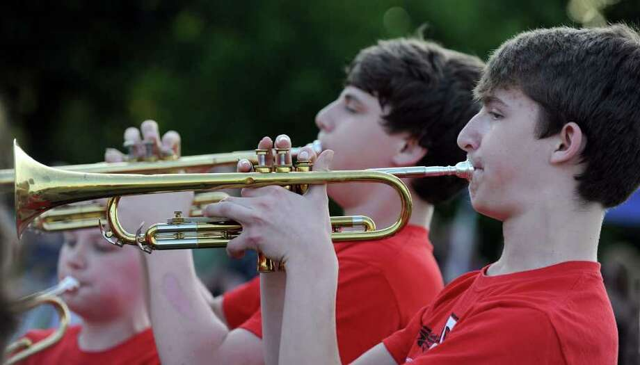 "Nathaniel Diamond, left, and Steven Kats, both 13, play trumpets during a rendition of  ""The Star Spangled Banner"" Tuesday evening during ""The Big Band Bash."" Photo taken Tuesday, May 31, 2011. Photo: Carol Kaliff / The News-Times"