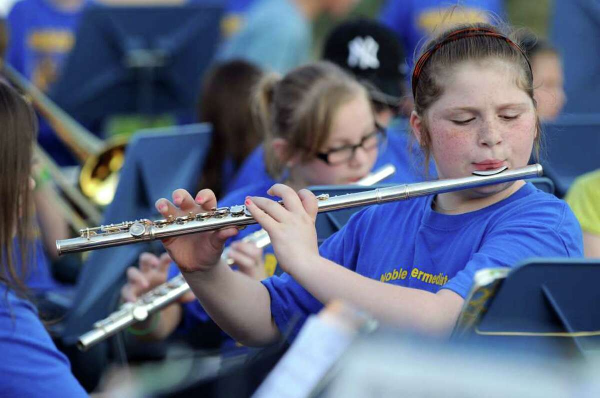 """Fifth-grader Haley Ranson, 11, plays the flute with the Sarah Noble band during """"The Big Band Bash"""" Tuesday, May 31, 2011."""