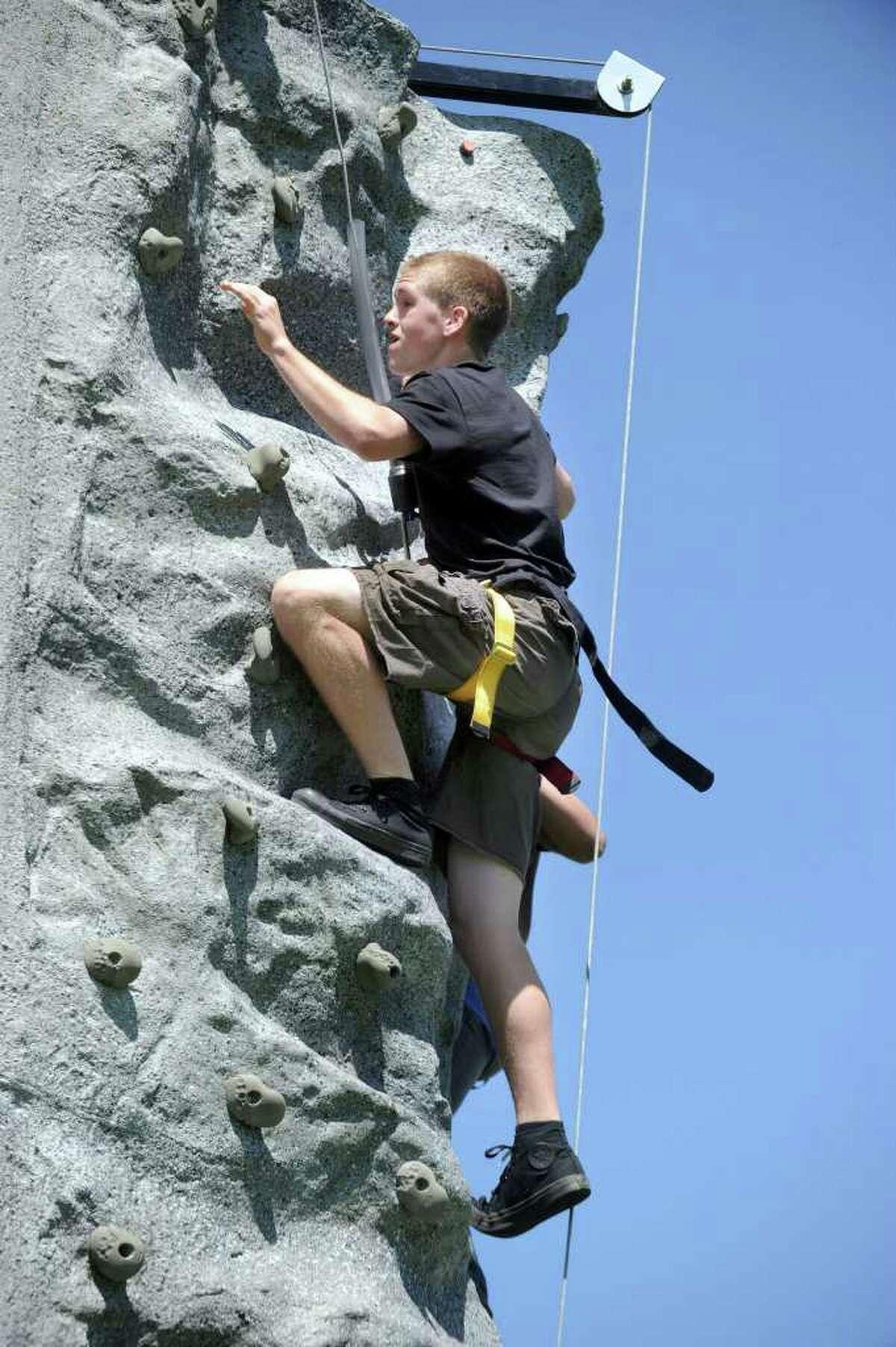 Josh Tamburino, 16, climbs the rock wall at Bethel High School during an ROTC activity, Thursday, June 2, 2011.