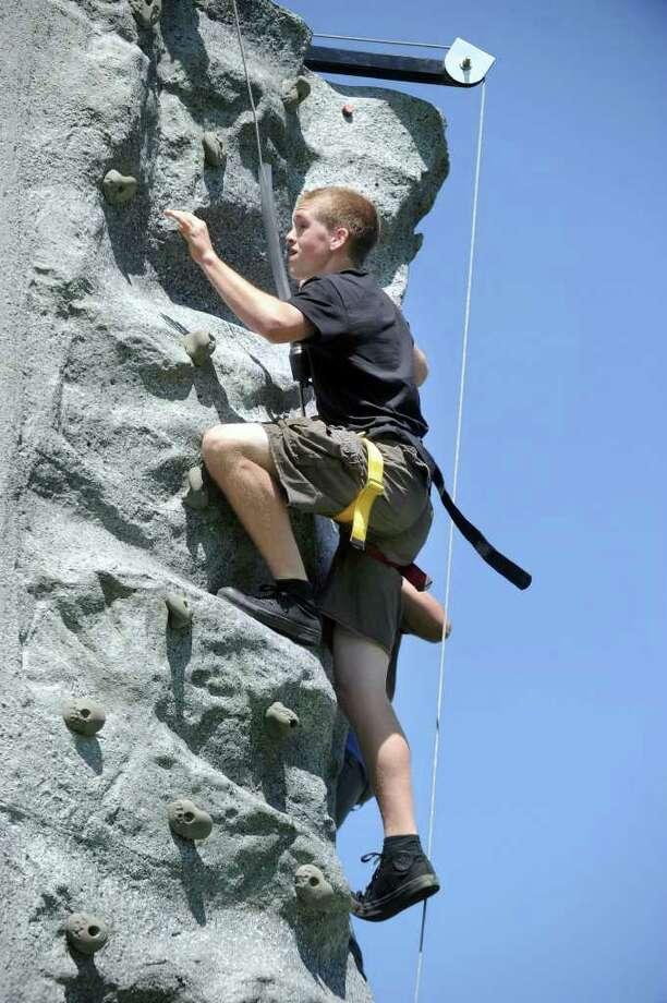 Josh Tamburino, 16, climbs the rock wall at Bethel High School during an ROTC activity, Thursday, June 2, 2011. Photo: Carol Kaliff / The News-Times