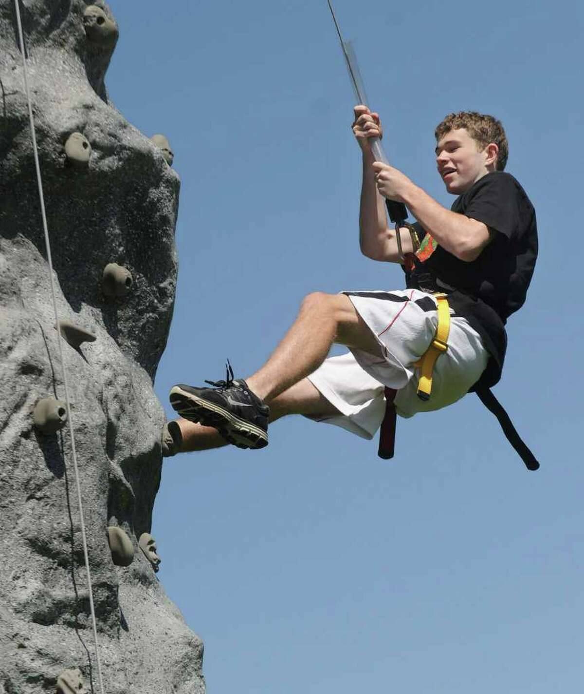 Griffin Teed, 16, climbs the rock wall during an ROTC activity at Bethel High School Thursday, June 2, 2011.