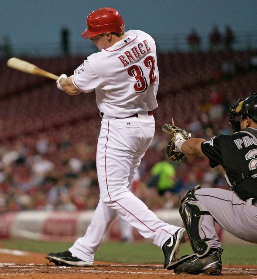 Cincinnati Reds' Jay Bruce (32) hits a single off Florida Marlins starter Anibal Sanchez to drive in two runs in the first inning of a baseball game, Thursday, Sept. 17, 2009, in Cincinnati. Marlins catcher Ronny Paulino, right, looks on. (AP Photo/Al Behrman) Photo: Al Behrman, STF / Beaumont