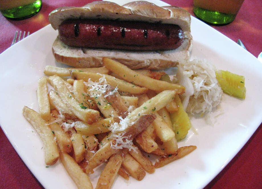 The thick and meaty Kobe beef hot dog is accompanied by truffle fries. JENNIFER McINNIS / EXPRESS-NEWS