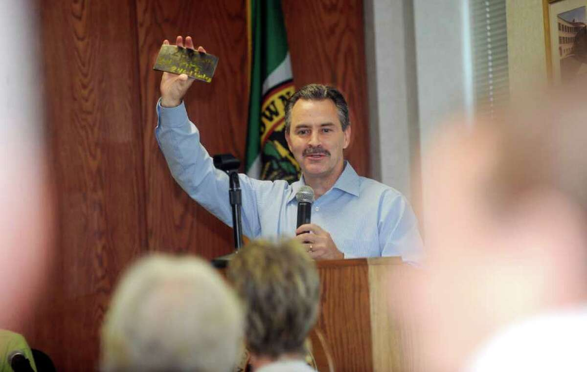 Bennie Barnes, director of pipeline risk management for the Tennessee Gas Transmission Company holds up a piece of the pipe on Thursday, June 2, 2011, at a public conference concerning the interstate gas pipeline in Fairfield County at Greenwich Town Hall.