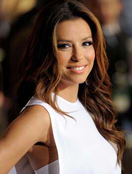 "Eva Longoria will sign copies of her book, ""Eva's Kitchen,"" Saturday at La Cantera. CHRIS PIZZELLO / AP"