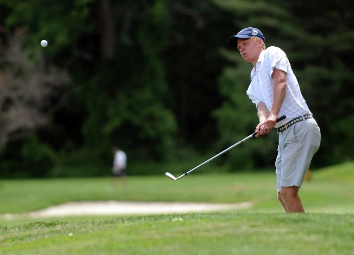 Darien's Andrew Winter chips his ball onto the green during the FCIAC championship golf tournament Thursday, June 2, 2011 at Fairchild Wheeler Golf Course in Fairfield, Conn.