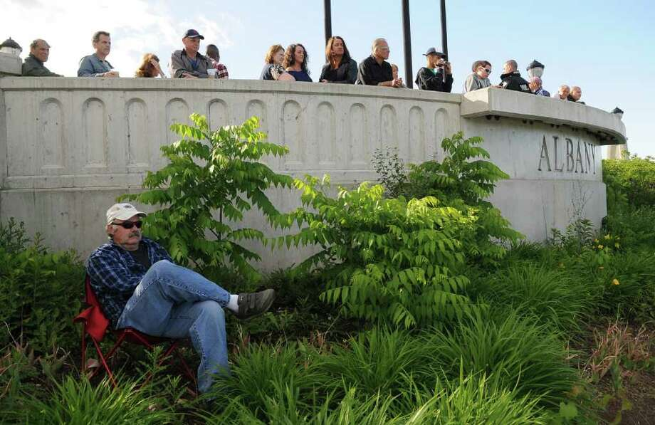 A concertgoer sits in his favorite spot in the Corning Preserve during Alive at Five on Thursday evening June 2, 2011 in Albany, NY.  Although he didn't want to give his name, he said that the space give him a good view. ( Philip Kamrass / Times Union) Photo: Philip Kamrass