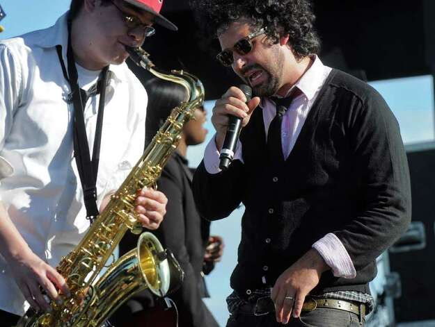 "Mirk lead singer Joshua ""Mirk"" Mirsky, right, sings with saxophone player Chris Russell in the Corning Preserve during Alive at Five on Thursday evening June 2, 2011 in Albany, NY.  Mirk opened for Vertical Horizon. ( Philip Kamrass / Times Union) Photo: Philip Kamrass"