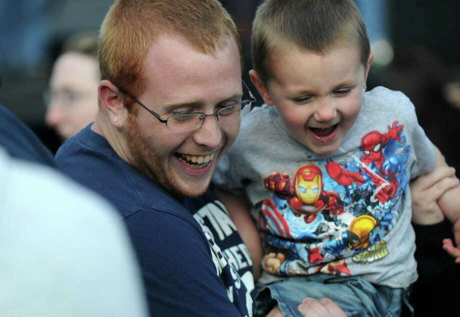 Joe Ogden of Rensselaer laughs with nephew Lee Connell, 3,  during Alive at Five on Thursday evening June 2, 2011 in Albany, NY. Mirk opened for Vertical Horizon. ( Philip Kamrass / Times Union) Photo: Philip Kamrass