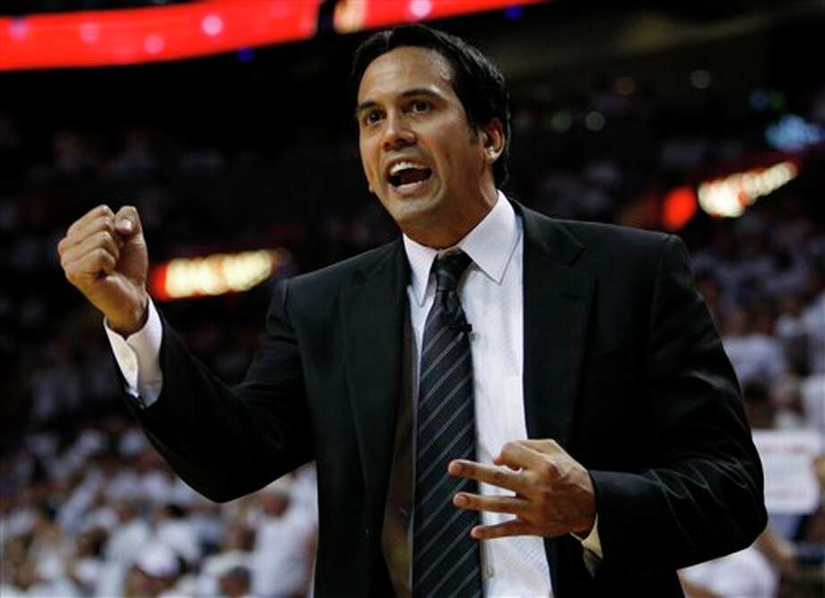 Miami Heat's head coach Erik Spoelstra gestures to his team during the first half of Game 2 of the NBA Finals basketball game against the Dallas Mavericks, Thursday, June 2, 2011, in Miami. (AP Photo/Wilfredo Lee) Photo: Wilfredo Lee, Associated Press / AP