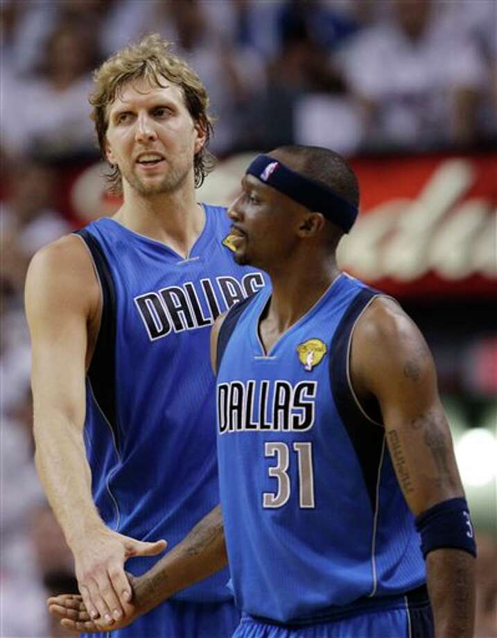 Dallas Mavericks' Jason Terry (31) and Dirk Nowitzki shakes hands during the first half of Game 2 of the NBA Finals basketball game against the Miami Heat, Thursday, June 2, 2011, in Miami. (AP Photo/David J. Phillip) Photo: David J. Phillip, Associated Press / AP
