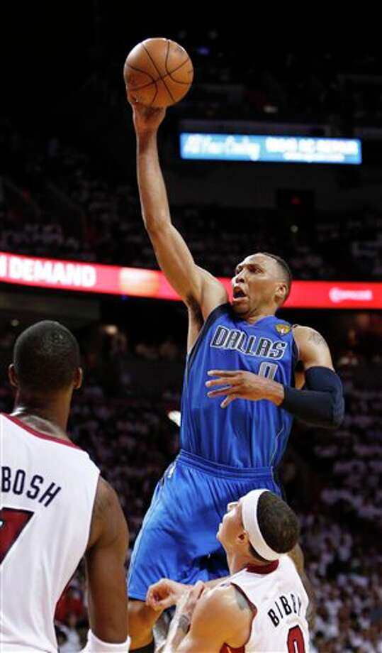 Dallas Mavericks' Shawn Marion (0) goes for a basket over Miami Heat's Mike Bibby and Chris Bosh during the second half of Game 2 of the NBA Finals basketball game Thursday, June 2, 2011, in Miami. (AP Photo/Wilfredo Lee) Photo: Wilfredo Lee, Associated Press / AP