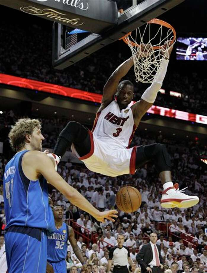 Miami Heat's Dwyane Wade (3) dunks the ball over Dallas Mavericks' Dirk Nowitzki (41) during the second half of Game 2 of the NBA Finals basketball game Thursday, June 2, 2011, in Miami. (AP Photo/David J. Phillip) Photo: David J. Phillip, Associated Press / AP