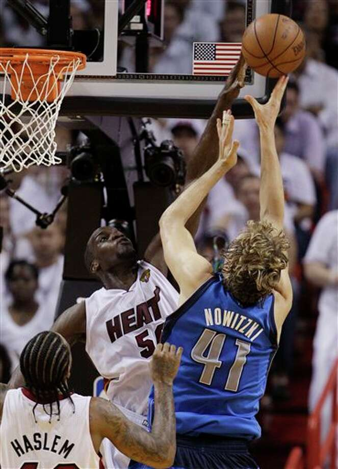 Miami Heat's Joel Anthony (50) blocks a shot by Dallas Mavericks' Dirk Nowitzki (41) during the second half of Game 2 of the NBA Finals basketball game Thursday, June 2, 2011, in Miami. (AP Photo/David J. Phillip) Photo: David J. Phillip, Associated Press / AP