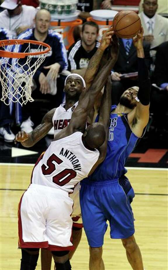Miami Heat's LeBron James and Joel Anthony (50) defend Dallas Mavericks' Tyson Chandler (6) drive to the basket during the first half of Game 2 of the NBA Finals basketball game Thursday, June 2, 2011, in Miami. (AP Photo/David J. Phillip) Photo: David J. Phillip, Associated Press / AP