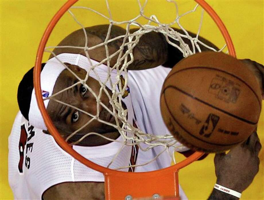 Miami Heat's LeBron James watches his shot through the net during Game 2 of the NBA Finals basketball game against the Dallas Mavericks Thursday, June 2, 2011, in Miami. (AP Photo/David J. Phillip; Pool) Photo: David J. Phillip, Associated Press / AP Pool