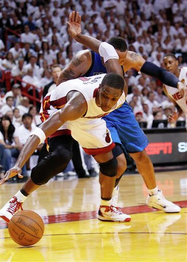 Miami Heat's Chris Bosh takes control of a loose ball over Dallas Mavericks' Shawn Marion during the second half of Game 2 of the NBA Finals basketball game Thursday, June 2, 2011, in Miami. (AP Photo/Wilfredo Lee) Photo: Wilfredo Lee, Associated Press / AP