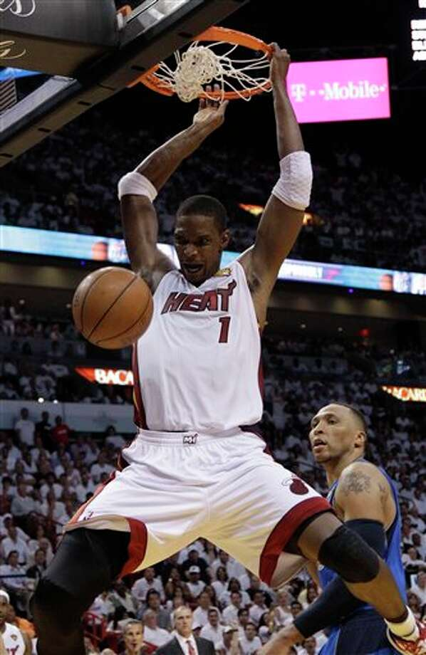Miami Heat's Chris Bosh (1) dunks the ball over Dallas Mavericks' Shawn Marion during the second half of Game 2 of the NBA Finals basketball game Thursday, June 2, 2011, in Miami. (AP Photo/David J. Phillip) Photo: David J. Phillip, Associated Press / AP