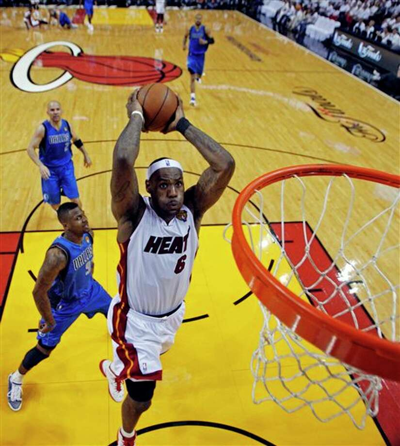 Miami Heat's LeBron James (6) goes up for a dunk during the second half of Game 2 of the NBA Finals basketball game against the Dallas Mavericks Thursday, June 2, 2011, in Miami. (AP Photo/Mike Segar; Pool) Photo: Mike Segar, Associated Press / Reuters; Pool