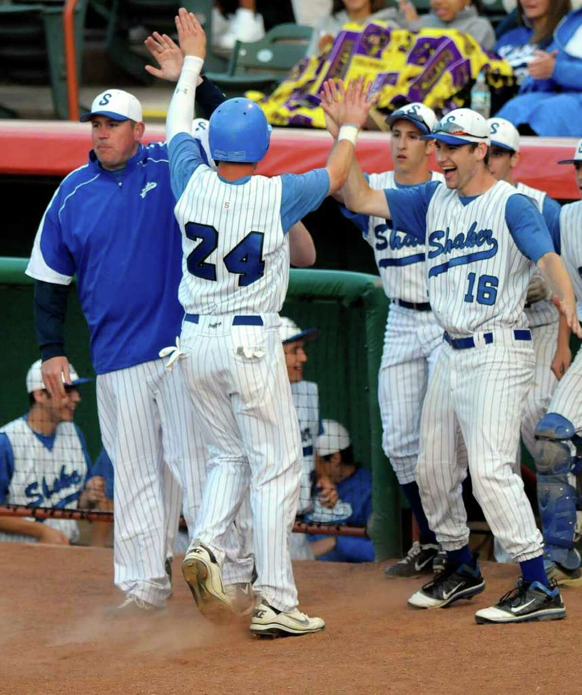 Shaker's Drew Lasky (24) celebrates a scoring run with teammates against Colonie during a Class AA baseball final between final in Troy, N.Y., Thursday, June 2, 2011. (Hans Pennink / Special to the Times Union) High School Sports